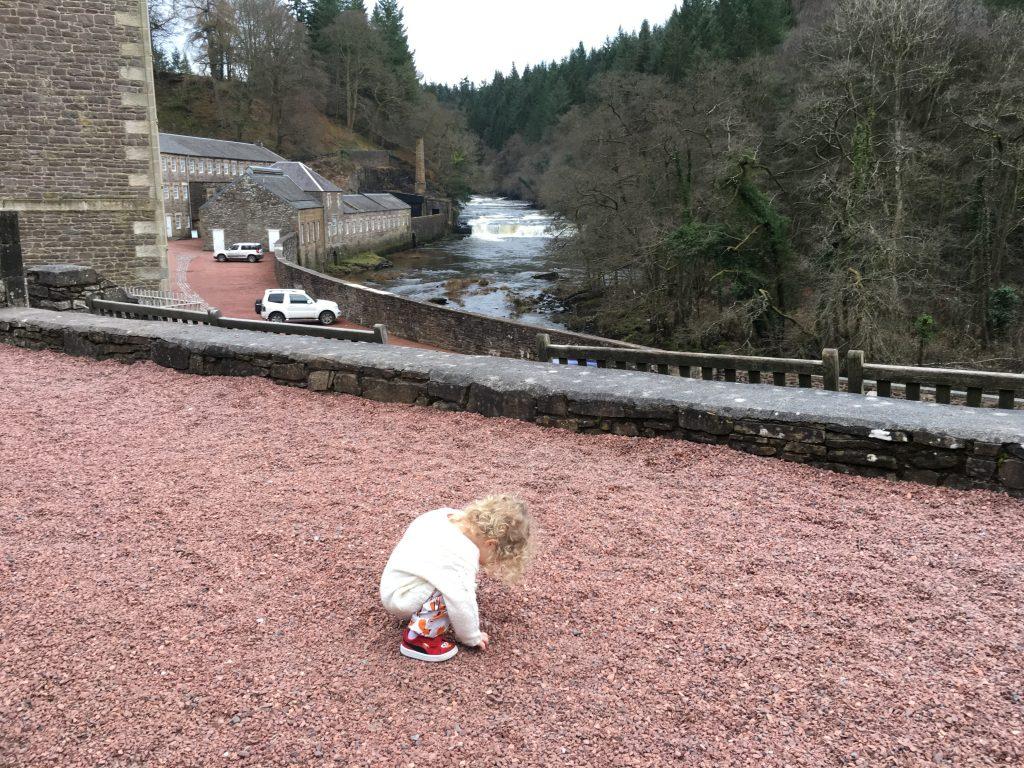 new-lanark-toddler-playing-in-stones